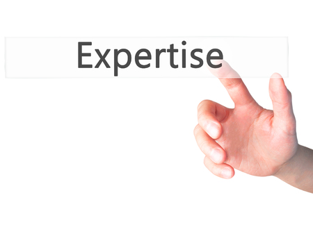 ingenuity: Expertise - Hand pressing a button on blurred background concept . Business, technology, internet concept. Stock Photo