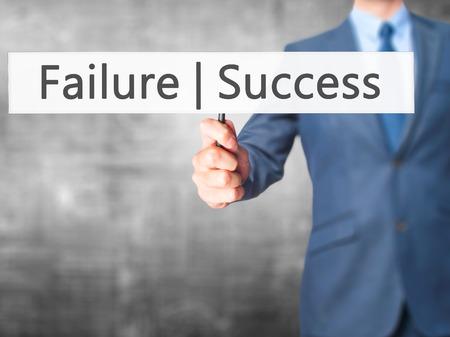 opt: Failure Success - Businessman hand holding sign. Business, technology, internet concept. Stock Photo
