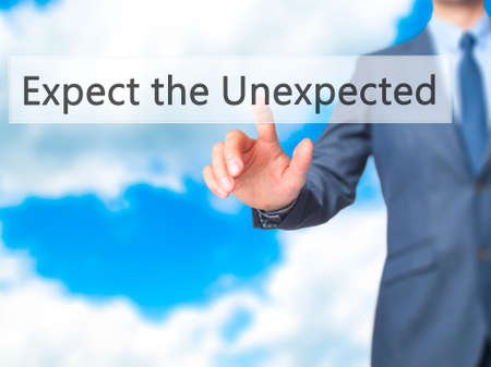 unexpected: Expect the Unexpected - Businessman hand pressing button on touch screen interface. Business, technology, internet concept. Stock Photo