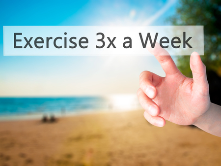 living wisdom: Exercise 3x a Week - Hand pressing a button on blurred background concept . Business, technology, internet concept. Stock Photo Stock Photo
