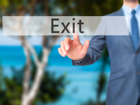 divorcing: Exit - Businessman hand pressing button on touch screen interface. Business, technology, internet concept. Stock Photo