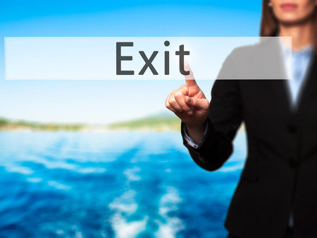 downsize: Exit - Businesswoman hand pressing button on touch screen interface. Business, technology, internet concept. Stock Photo