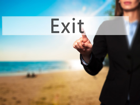 divorcing: Exit - Businesswoman hand pressing button on touch screen interface. Business, technology, internet concept. Stock Photo