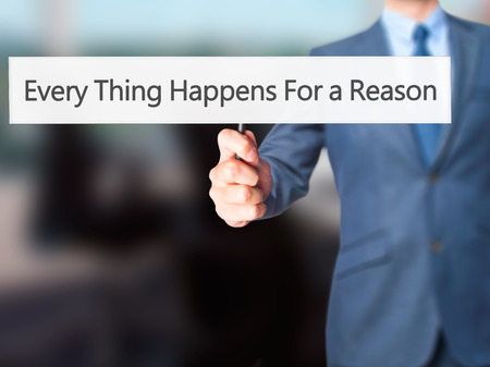 happenings: Every Thing Happens For a Reason - Businessman hand holding sign. Business, technology, internet concept. Stock Photo
