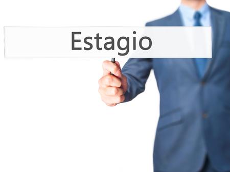 apprenticeship employee: Estagio (Internship in Portuguese) - Businessman hand holding sign. Business, technology, internet concept. Stock Photo