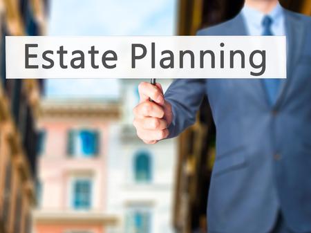 incapacity: Estate Planning - Businessman hand holding sign. Business, technology, internet concept. Stock Photo Stock Photo