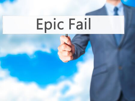 epic: Epic Fail - Businessman hand holding sign. Business, technology, internet concept. Stock Photo
