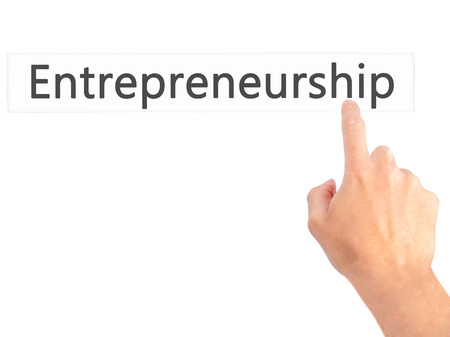company ownership: Entrepreneurship - Hand pressing a button on blurred background concept . Business, technology, internet concept. Stock Photo