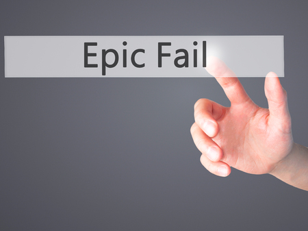 epic: Epic Fail - Hand pressing a button on blurred background concept . Business, technology, internet concept. Stock Photo Stock Photo
