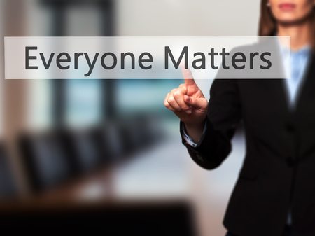 everyone: Everyone Matters - Businesswoman hand pressing button on touch screen interface. Business, technology, internet concept. Stock Photo