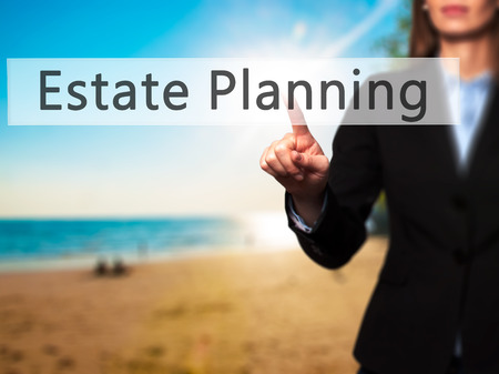 contingent: Estate Planning - Businesswoman hand pressing button on touch screen interface. Business, technology, internet concept. Stock Photo Stock Photo