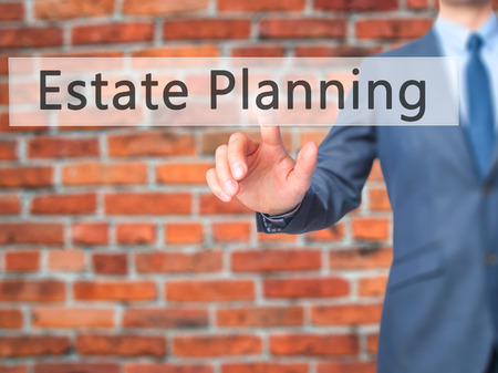 estate planning: Estate Planning - Businessman hand pressing button on touch screen interface. Business, technology, internet concept. Stock Photo