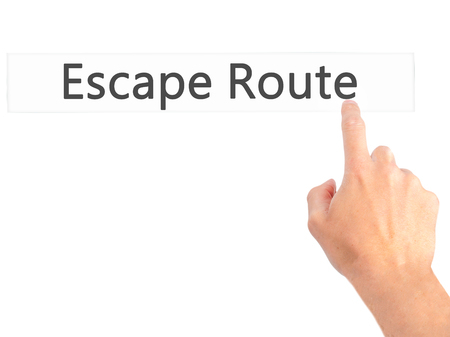 breakout: Escape Route - Hand pressing a button on blurred background concept . Business, technology, internet concept. Stock Photo