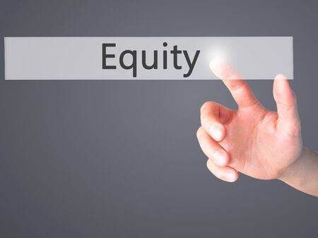 equidad: Equity - Hand pressing a button on blurred background concept . Business, technology, internet concept. Stock Photo Foto de archivo