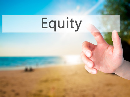 equity: Equity - Hand pressing a button on blurred background concept . Business, technology, internet concept. Stock Photo Foto de archivo
