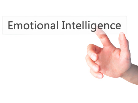 emotionality: Emotional Intelligence - Hand pressing a button on blurred background concept . Business, technology, internet concept. Stock Photo