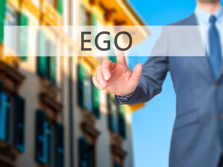 conceited: Ego - Businessman hand pressing button on touch screen interface. Business, technology, internet concept. Stock Photo