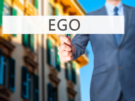 ego: Ego - Businessman hand holding sign. Business, technology, internet concept. Stock Photo