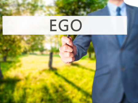 pretentious: Ego - Businessman hand holding sign. Business, technology, internet concept. Stock Photo