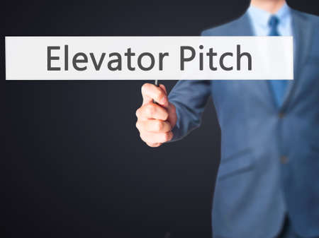 business pitch: Elevator Pitch - Businessman hand holding sign. Business, technology, internet concept. Stock Photo Stock Photo