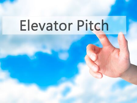 business pitch: Elevator Pitch - Hand pressing a button on blurred background concept . Business, technology, internet concept. Stock Photo