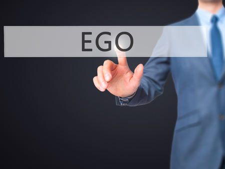 pretentious: Ego - Businessman hand pressing button on touch screen interface. Business, technology, internet concept. Stock Photo