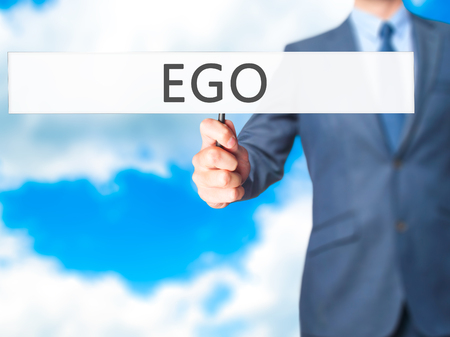 pompous: Ego - Businessman hand holding sign. Business, technology, internet concept. Stock Photo