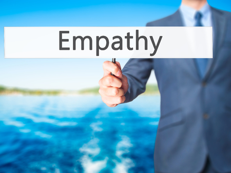 humanism: Empathy - Businessman hand holding sign. Business, technology, internet concept. Stock Photo