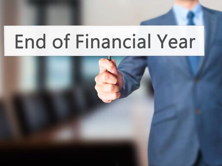 jurisdictions: End of Financial Year - Businessman hand holding sign. Business, technology, internet concept. Stock Photo