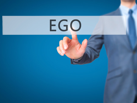 narcissism: Ego - Businessman hand pressing button on touch screen interface. Business, technology, internet concept. Stock Photo