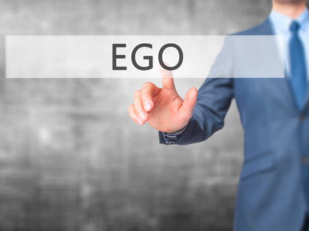 pompous: Ego - Businessman hand pressing button on touch screen interface. Business, technology, internet concept. Stock Photo