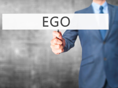 narcissism: Ego - Businessman hand holding sign. Business, technology, internet concept. Stock Photo