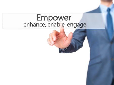 enable: Empower enhance, enable, engage - Businessman hand pressing button on touch screen interface. Business, technology, internet concept. Stock Photo