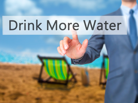 living wisdom: Drink More Water - Businessman hand pressing button on touch screen interface. Business, technology, internet concept. Stock Photo