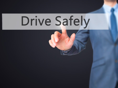 cautionary: Drive Safely - Businessman hand pressing button on touch screen interface. Business, technology, internet concept. Stock Photo