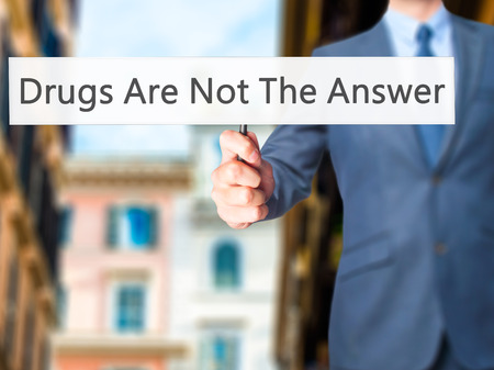 health answers: Drugs Are Not The Answer - Businessman hand holding sign. Business, technology, internet concept. Stock Photo