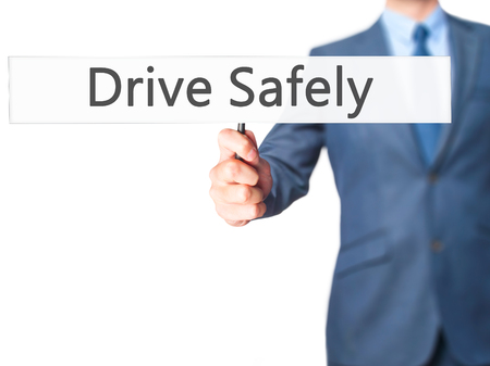 Drive Safely - Businessman hand holding sign. Business, technology, internet concept. Stock Photo
