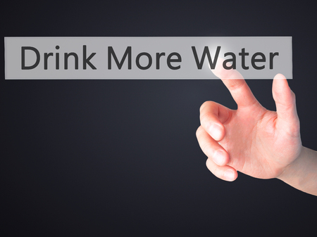 living wisdom: Drink More Water - Hand pressing a button on blurred background concept . Business, technology, internet concept. Stock Photo Stock Photo