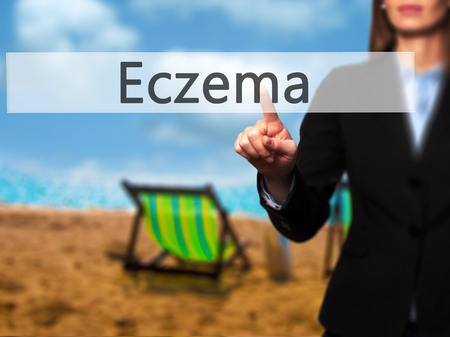 eczema: Eczema - Businesswoman hand pressing button on touch screen interface. Business, technology, internet concept. Stock Photo Stock Photo