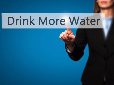 living wisdom: Drink More Water - Businesswoman hand pressing button on touch screen interface. Business, technology, internet concept. Stock Photo
