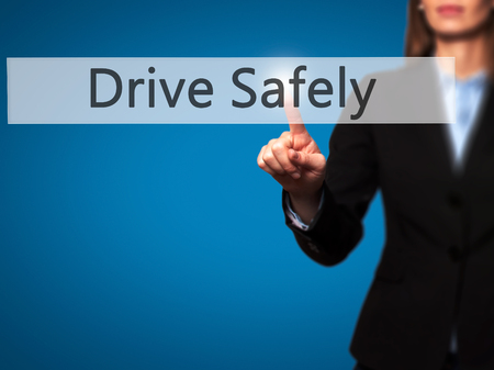 cautionary: Drive Safely - Businesswoman hand pressing button on touch screen interface. Business, technology, internet concept. Stock Photo