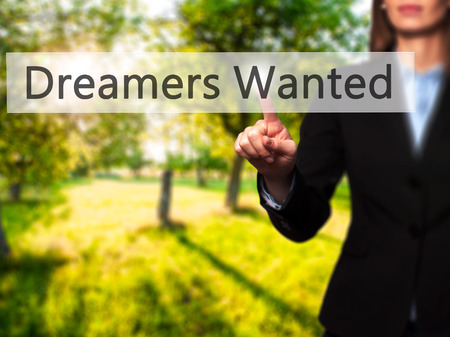 innovator: Dreamers Wanted - Businesswoman hand pressing button on touch screen interface. Business, technology, internet concept. Stock Photo