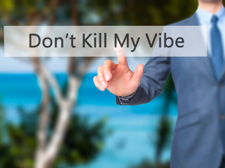 positivismo: Dont Kill My Vibe - Businessman hand pressing button on touch screen interface. Business, technology, internet concept. Stock Photo