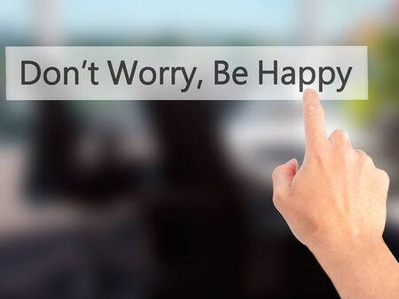 dont worry: Dont Worry, Be Happy - Hand pressing a button on blurred background concept . Business, technology, internet concept. Stock Photo