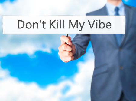 vibe: Dont Kill My Vibe - Businessman hand holding sign. Business, technology, internet concept. Stock Photo