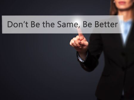 better button: Dont Be the Same, Be Better - Businesswoman hand pressing button on touch screen interface. Business, technology, internet concept. Stock Photo