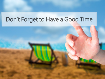 Don't Forget to Have a Good Time - Hand pressing a button on blurred background concept . Business, technology, internet concept. Stock Photo Banco de Imagens