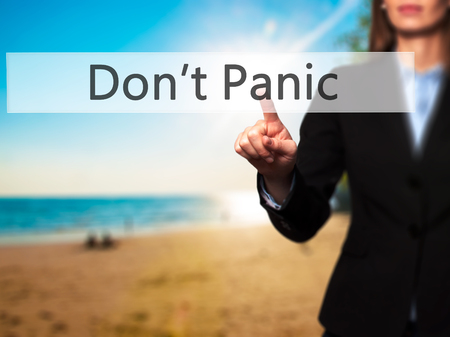 stay alert: Dont Panic - Businesswoman hand pressing button on touch screen interface. Business, technology, internet concept. Stock Photo
