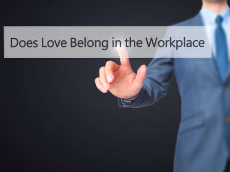does: Does Love Belong in the Workplace? - Businessman press on digital screen. Business,  internet concept. Stock Photo Stock Photo