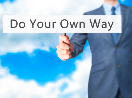 own: Do Your Own Way - Business man showing sign. Business, technology, internet concept. Stock Photo Stock Photo